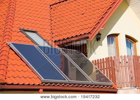 Solar panels on roof of modern family house