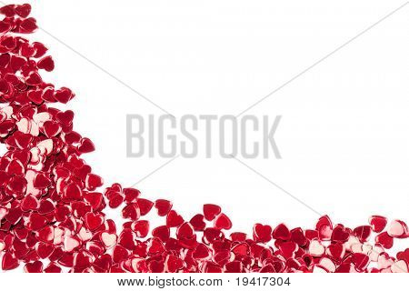 Valentines decoration of red confetti hearts against white background with copy pace