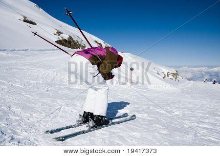 Woman downhill ski in alps on ski slope