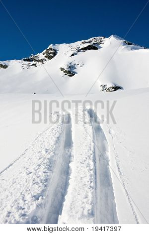 Ski trails on a mountain ouside the slope, off-piste