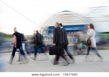Intentionally blurred image of people rushing to work in the morning