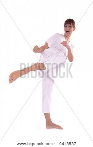 kung fu lady making barefoot kick - focus on feet