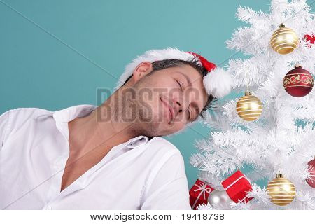cute man with red hat on christmas-tree