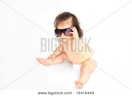 Cute little pampered baby wearing sunglasses