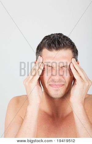 Man holding head having painful migraine
