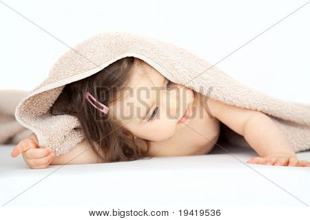 Little newborn toddler with towel