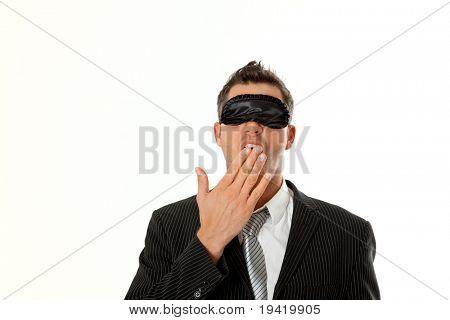 Sleepy tired businessman yawning in with sleep mask