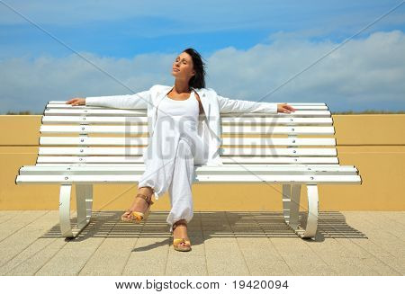 Outdoor sitting career business woman looking friendly