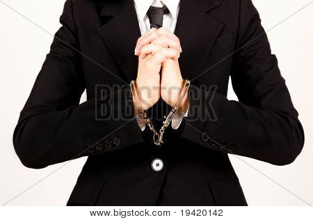 Handcuffed bank business holding hands