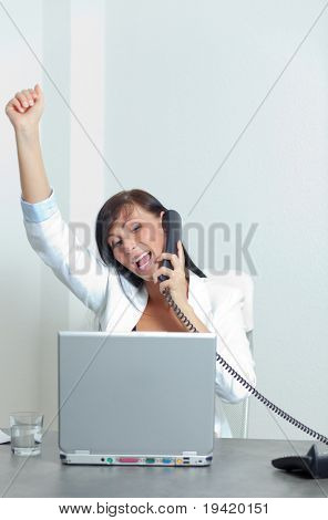 Arm rising happy smiling female chief manager phoning while getting professional career advancement