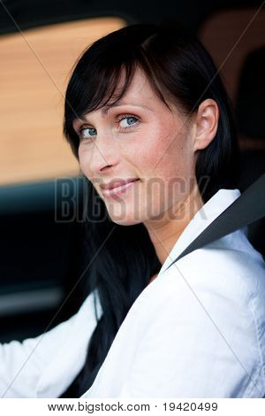 Woman in car with fasten seat belt