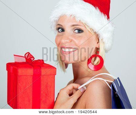 Alegre olhar comercial nude santa cláusula x-mas menina loira com sacos do caixa e loja de presente