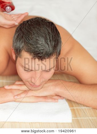 Relaxing man enjoying wellbeing wellness spa therapy