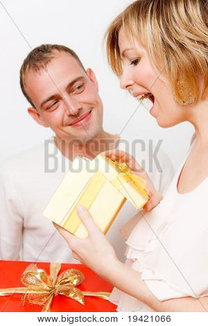 Lovely cute couple giving present being surprised