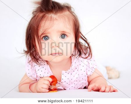 Innocent cheerful positive sweet looking baby