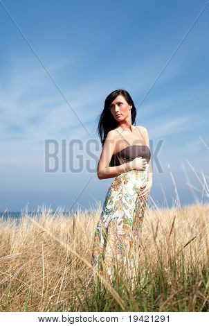 Relaxing natural woman in field breathing