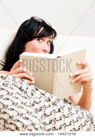 Book reading smiling casual girl relaxing woman having a break