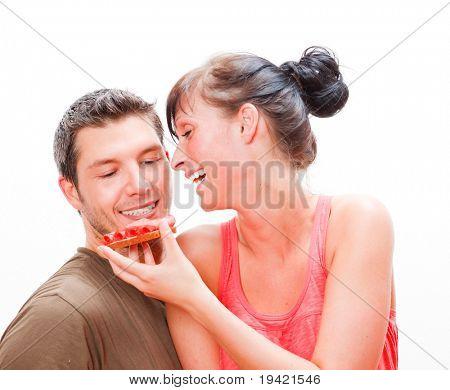Cheerful sweet feeding lovely couple
