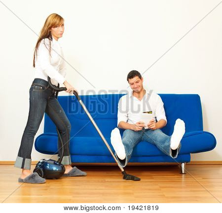 House and home apartment cleaning woman while boyfriend is relaxing
