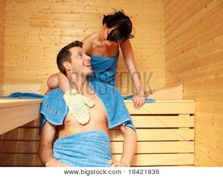 Healthcare healthy couple in finland sauna warming up and healing in a spa wellness resort cabin