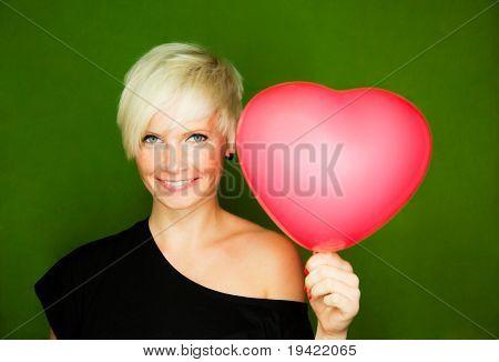 Female couple love girl holding red heart as gift for boyfriend