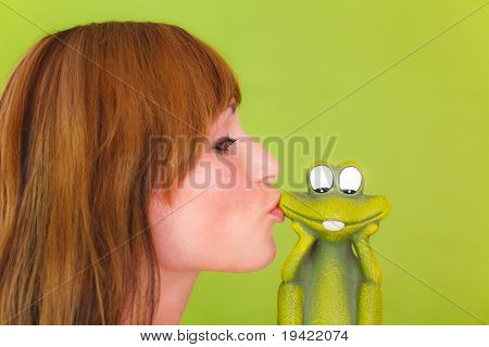Woman kissing frog as concept of a single girl relationship searching girl
