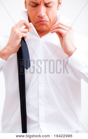 Businessman tighten cravat to climb up the social ladder and make career