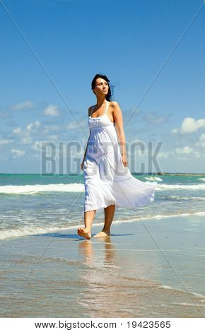 Female relaxing on coast growing success balance