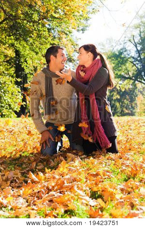 Portrait of couple enjoying golden autumn fall season