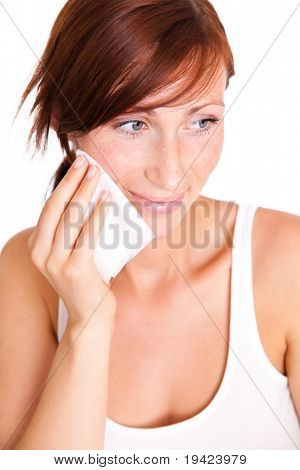Face cleaning woman removing make up from skin with cotton tissue pad