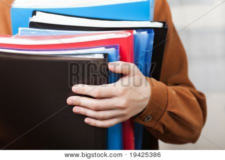 Business Paper Files In Hand