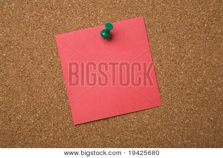 note pinned on a cork board