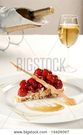 strawberry tart with glass of wine