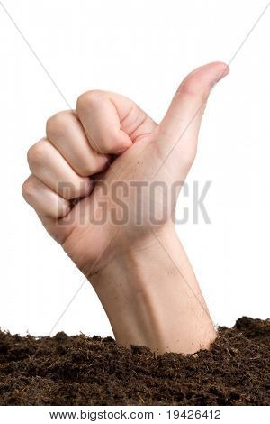 hand making o.k. sign emerging from earth