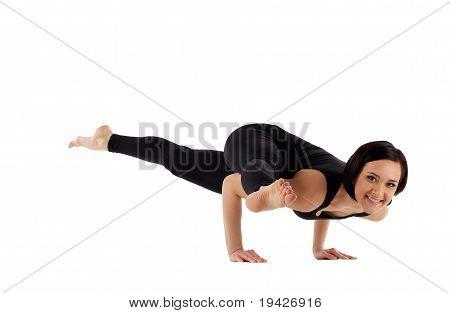 woman arm balance yoga - Eka Pada Koundiyanasana