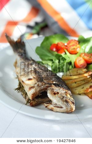 grilled seabass  served with chips  rocket and tomatoes