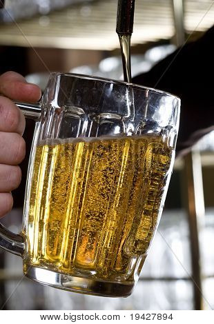 beer pouring from a tap