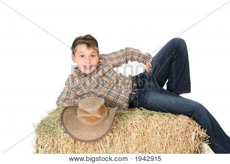 Rural Child Lying On Hay Bale