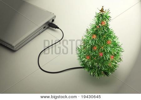 Christmas Vacation. USB Christmas tree connected to a laptop in an empty office. Christmas picture especially for internet related industry.