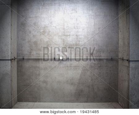 Montado en la pared de hormigón de construcción con la pipa.