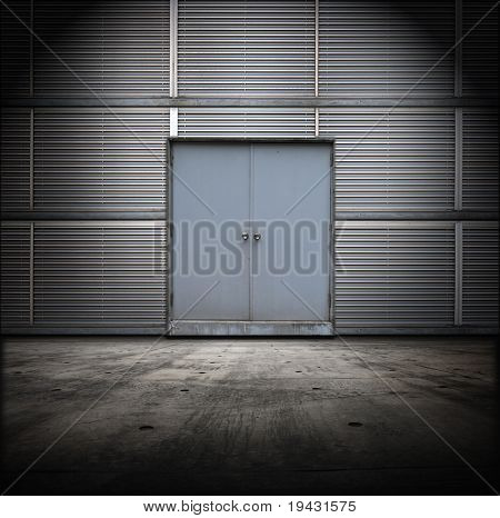 Classified room. Facility or Base type of grungy interior, with metal door and wall and concrete floor.
