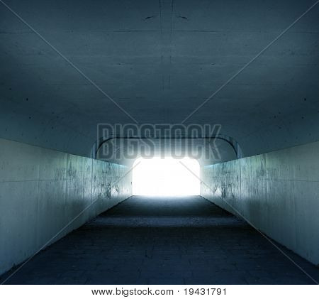 Inside a tunnel with light coming in from the exit or entrance.
