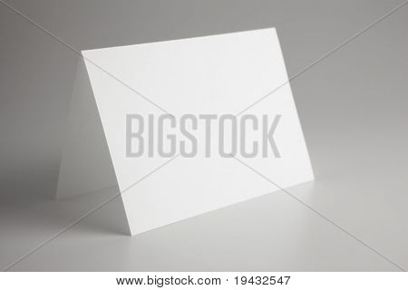 Blank paper sign , background is intentionally dark so sign stands out.