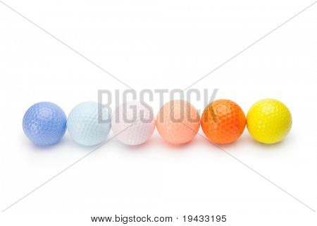 Colorful golf balls isolated on white.