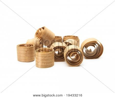 Wood shavings, beautifully curled in to a spiral by a hand plane. Isolated on white.