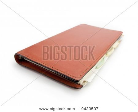 Diary or a schedule book in real world used condition, isolated on white. Leather cover.