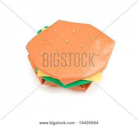 Um hambúrguer feito de papel de origami. Isolado no branco.