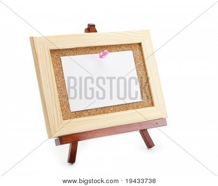 Miniature easel and miniature cork board with blank memo paper, for inserting your message . Isolated on white.