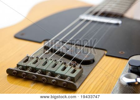 Vintage solid body guitar, isolated on white.