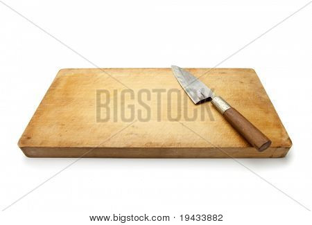 Knife and cutting board used in Japanese cuisine, in real life used condition. Isolated on white.